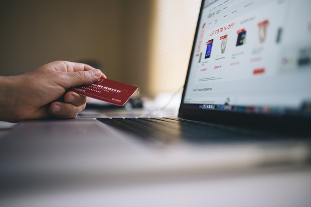Credit card in front of online store